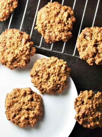 Peanut butter cookies on top of plate and rack.