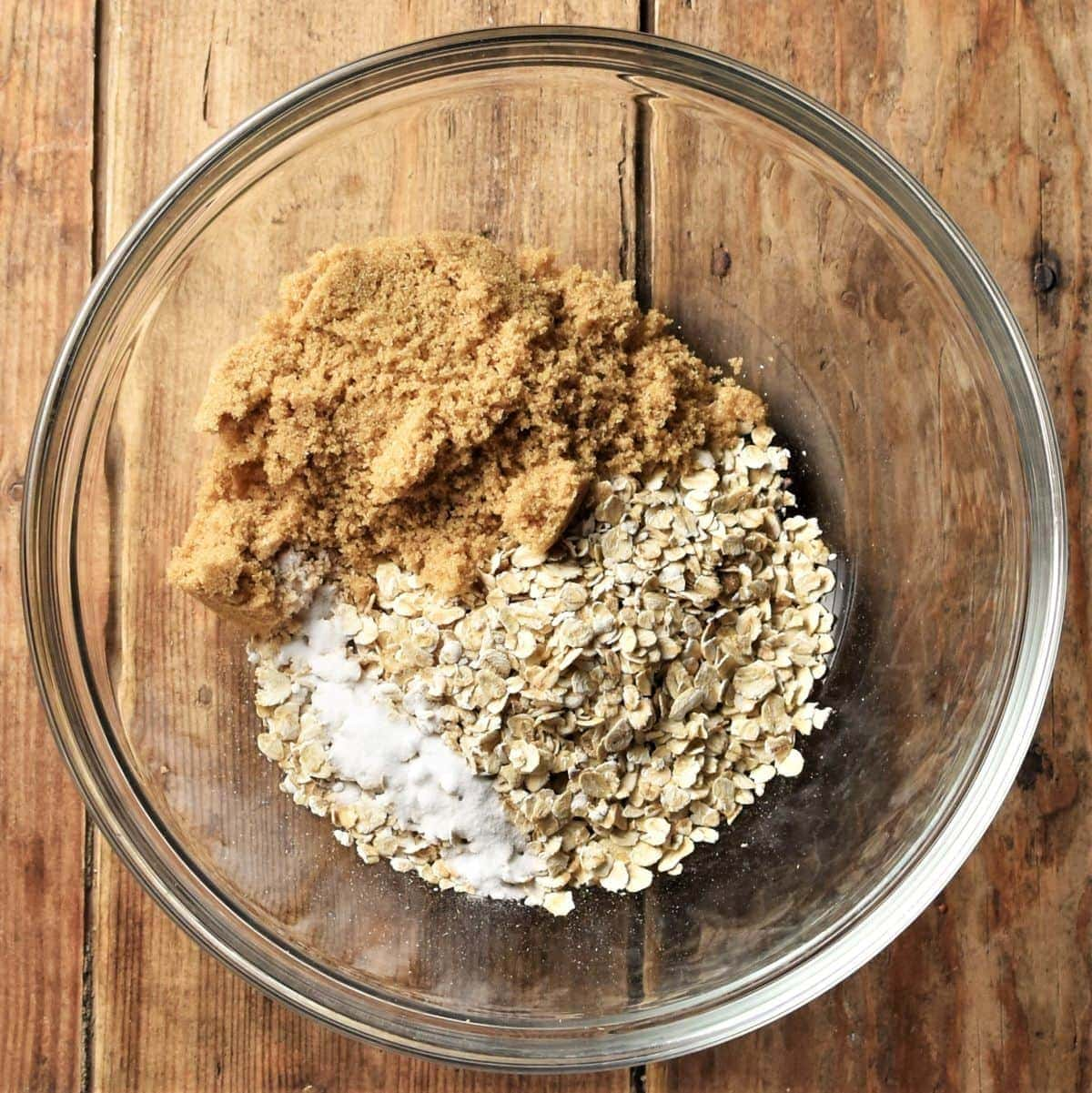 Oats and brown sugar in mixing bowl.