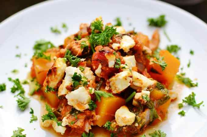 Easy tuna bake with butternut squash, spinach and feta on white plate.
