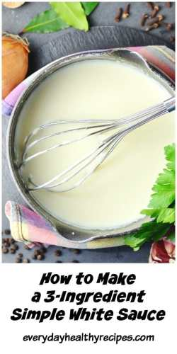Top down view of white sauce with metal whisk in saucepan wrapped in colourful cloth, with herbs and slices in background.