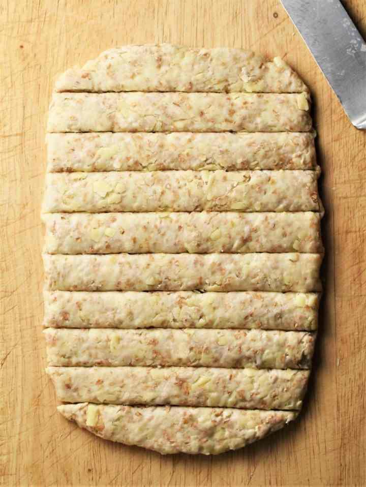 Rectangle dough cut into breadsticks.