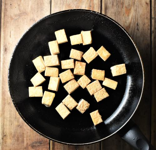 Cubed tofu in large pan.