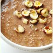 Partial view of mocha overnight oats with chopped hazelnuts in white bowl.