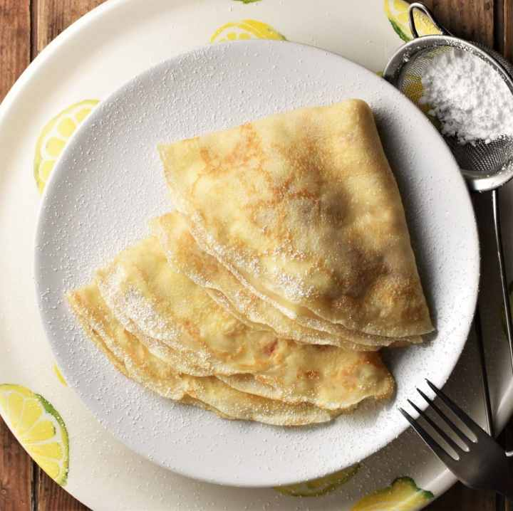 2 folded crepes on top of plate.