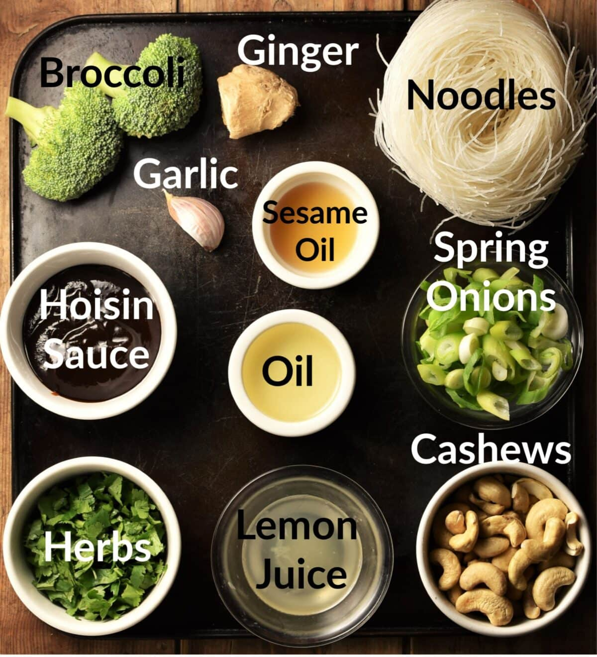 Noodle salad ingredients in individual dishes.