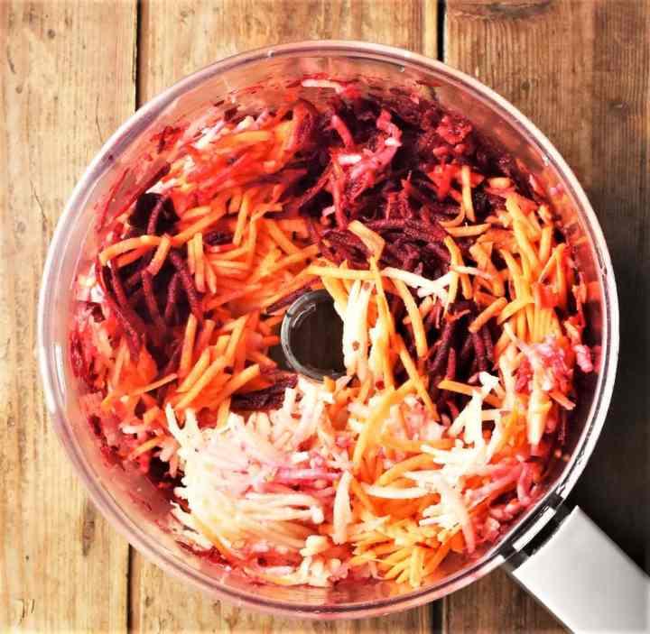 Shredding vegetables in food processor bowl.