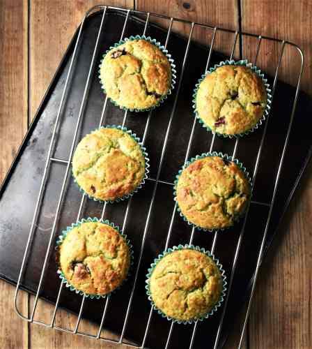 6 avocado raspberry muffins on top of rack.