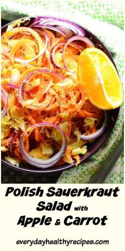 Top down view of sauerkraut carrot salad with onion and wedge of orange inside purple bowl wrapped in green cloth.