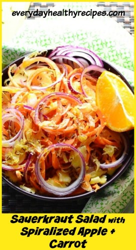 Top down view of Polish sauerkraut salad in purple bowl with orange and green cloth.