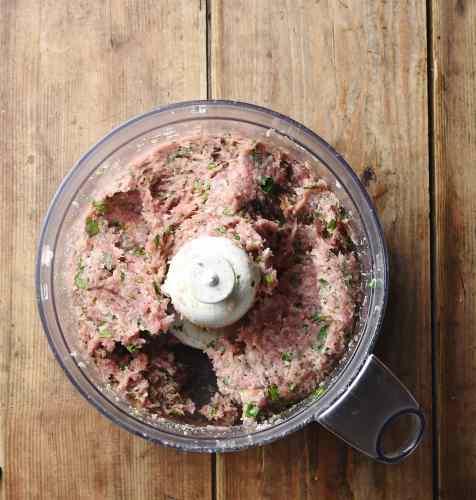 Meat stuffing mixture inside blender.