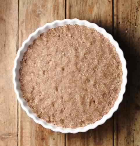 Pie base in white dish.