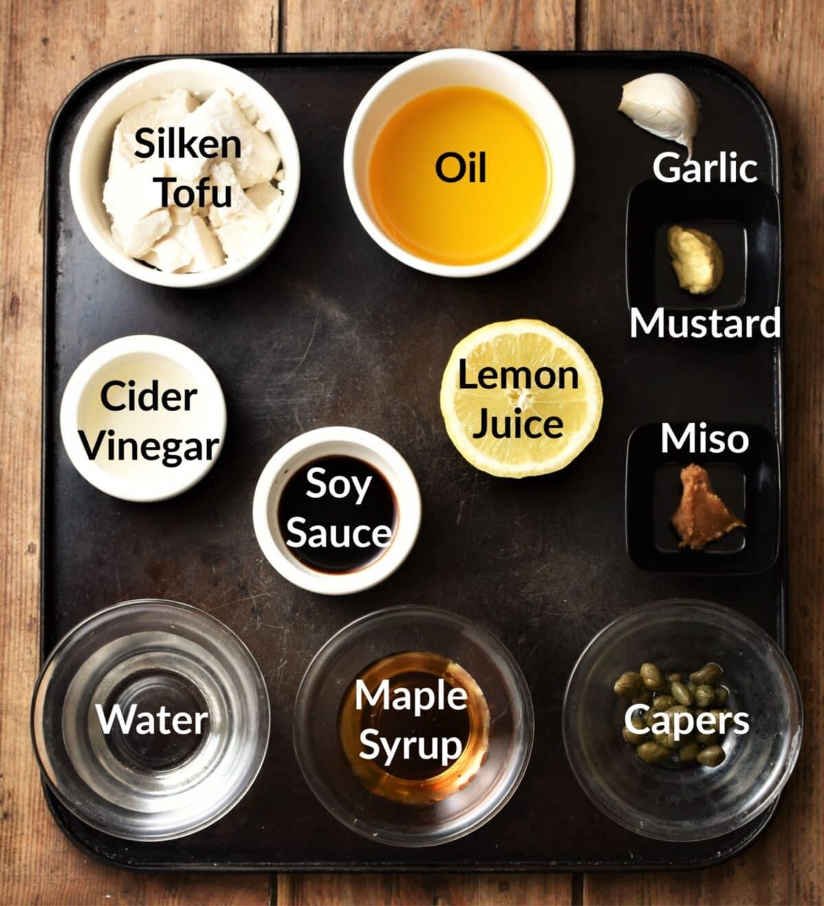 Vegan caesar salad dressing ingredients in individual dishes.