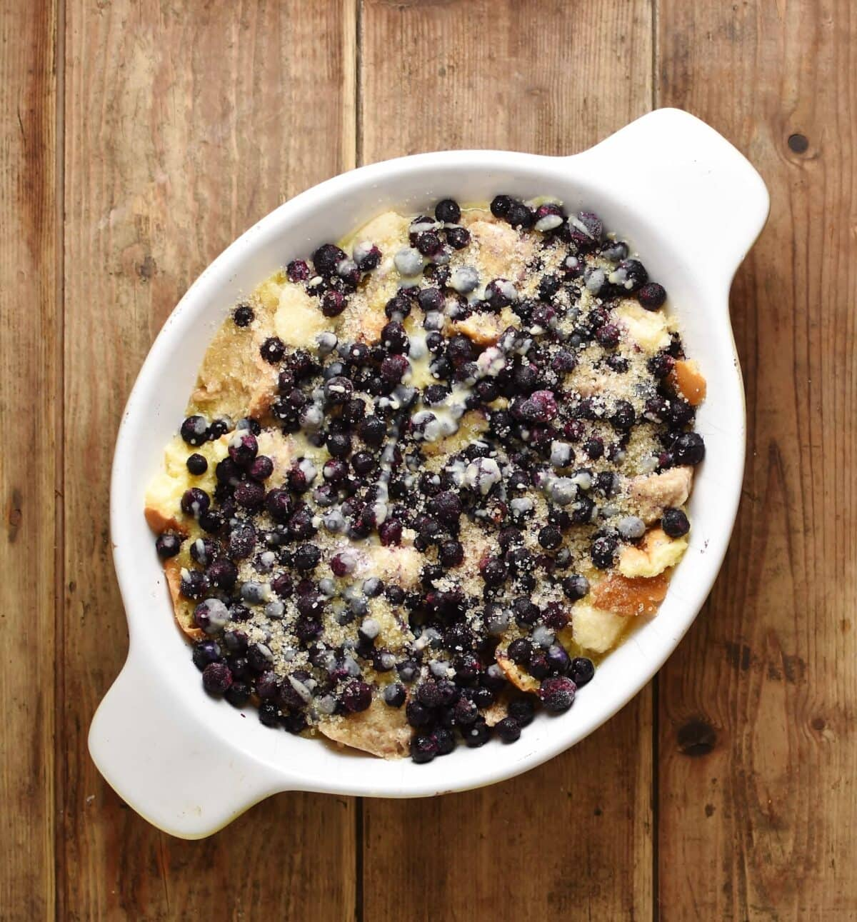 Blueberry french toast casserole in white oval dish.