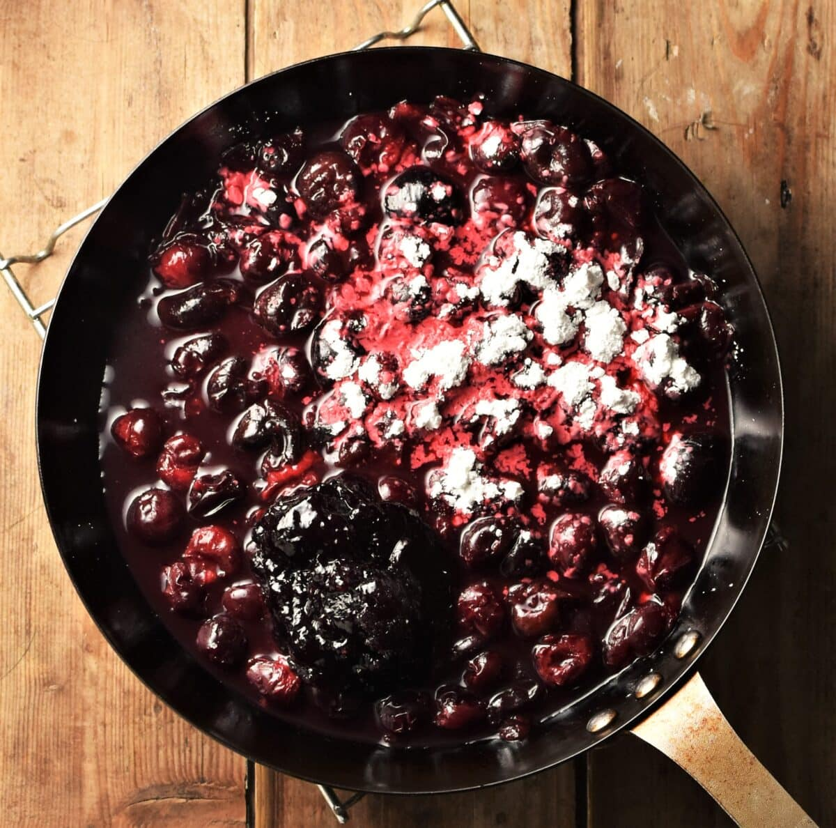 Cherry compote with flour in skillet.