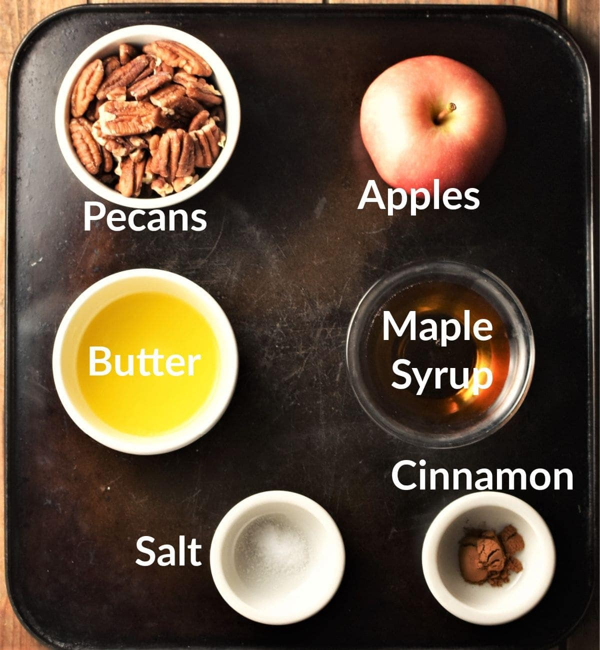 Healthy baked apples ingredients in individual dishes.
