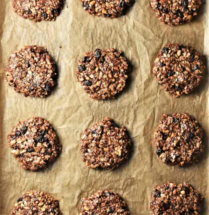 Chocolate oatmeal cookies on top of baking paper.