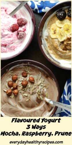 Flavoured mocha, raspberry and prune yogurt in purple bowls with spoons and blue-and-white cloth on dark brown surface.