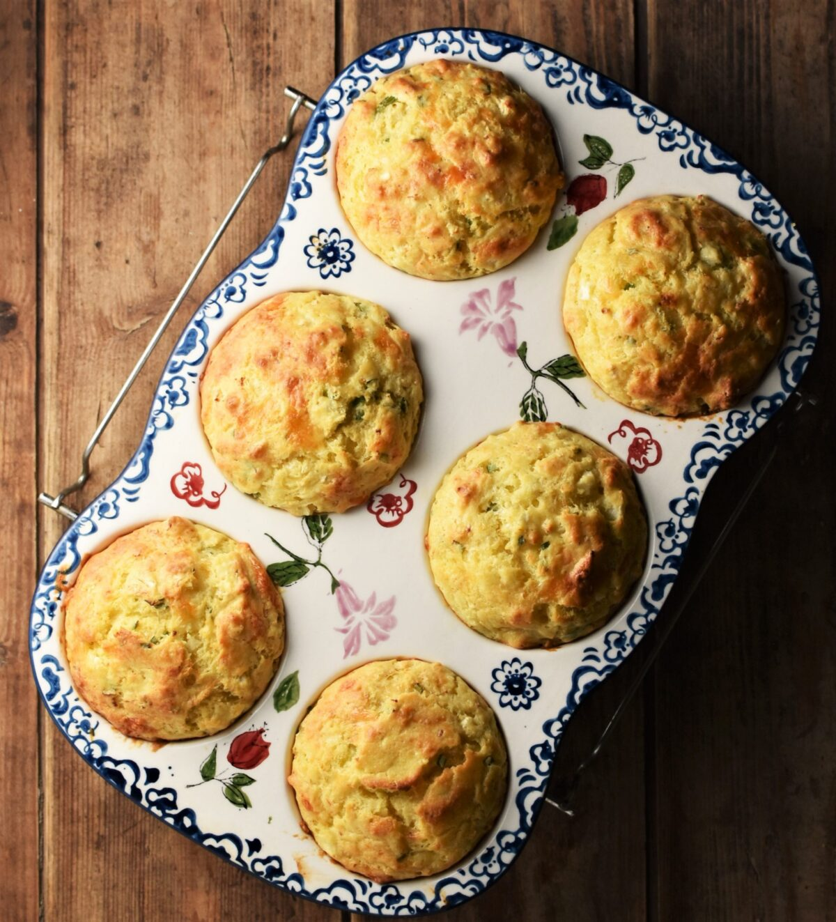 6 cauliflower muffins in ceramic white pan with blue flowery pattern.