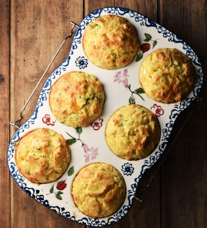6 cauliflower muffins in ceramic white pan with blue flowery pattern.