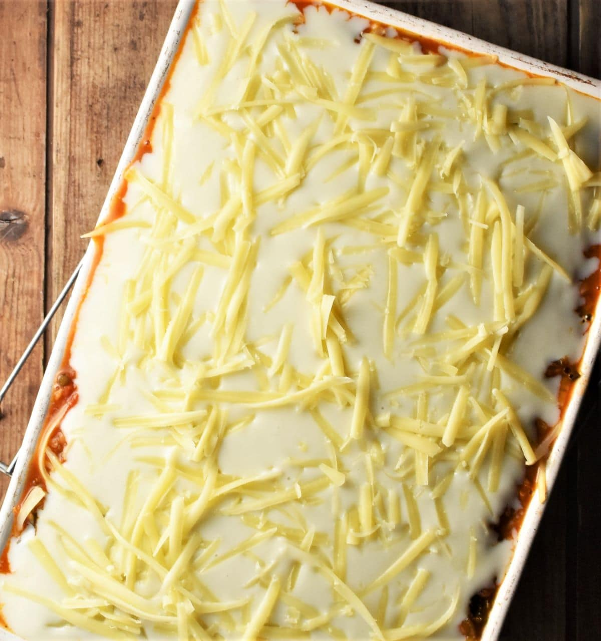 Lasagna with bechamel and grated cheese on top.