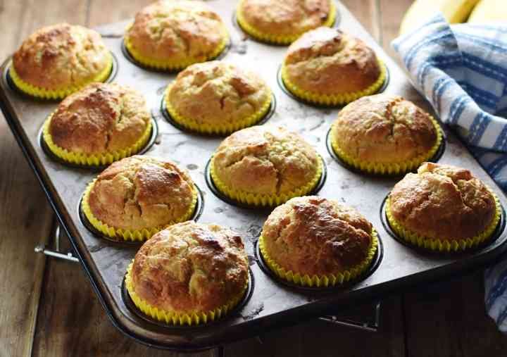 Side view of muffins in muffin pan.
