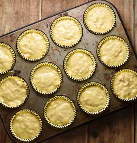 Muffin batter in muffin pan.