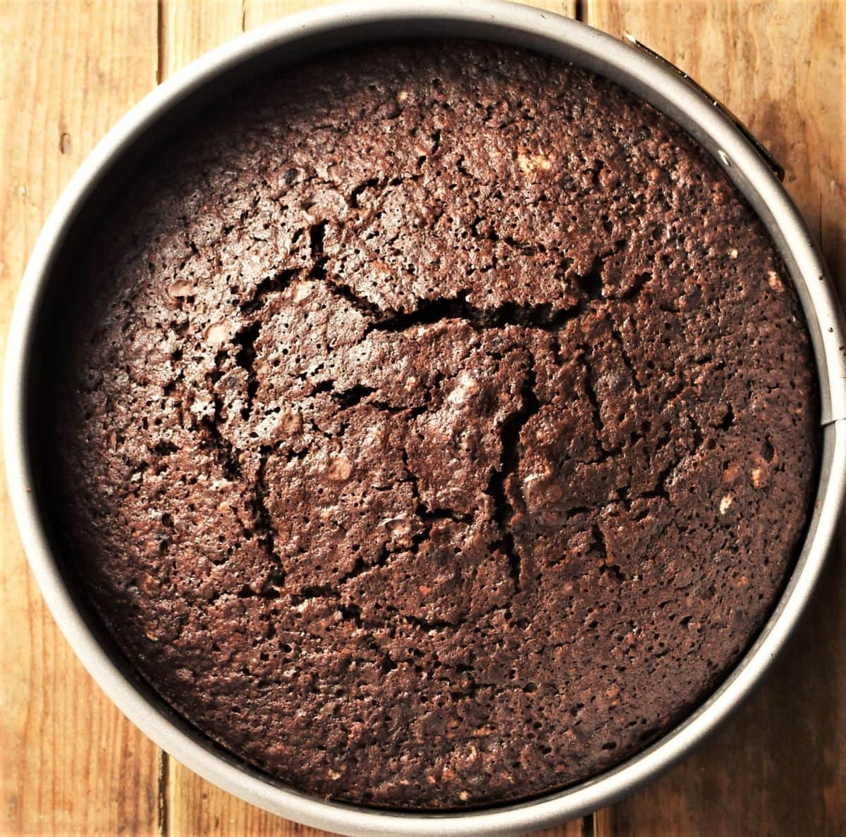 Ready baked chocolate cake in round pan.