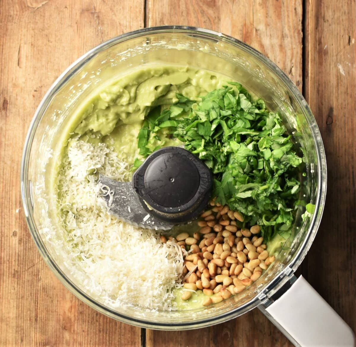 Avocado pesto ingredients in blender.