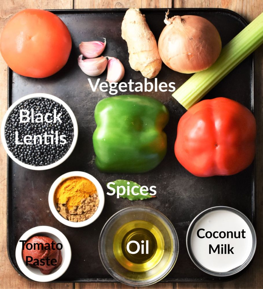 Curried black lentils recipe ingredients in individual dishes.