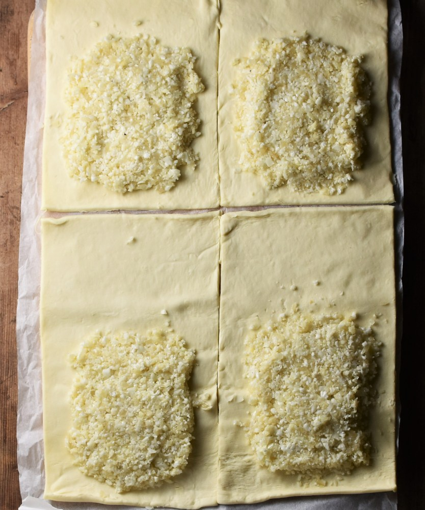 Cauliflower mixture on top of 4 rectangular pieces of pastry.