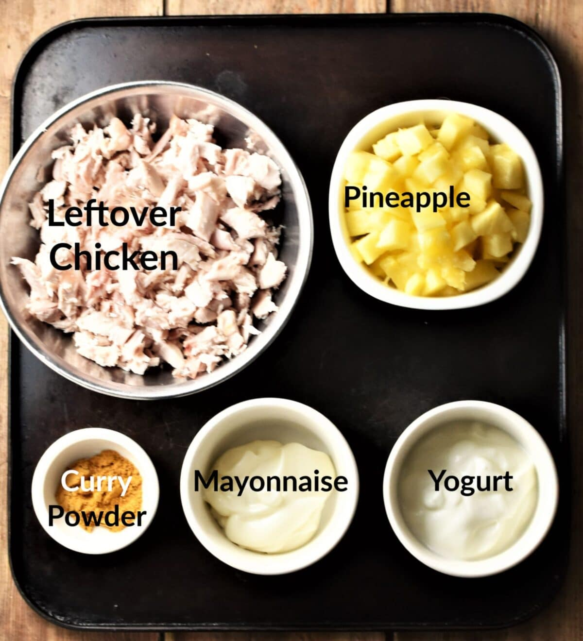 Chicken and pineapple salad ingredients in individual dishes.