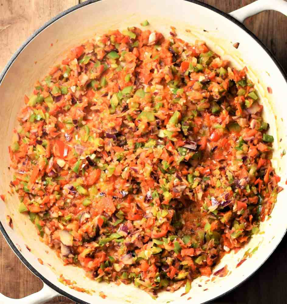 Ground meat and chopped vegetable mixture in large white pan.