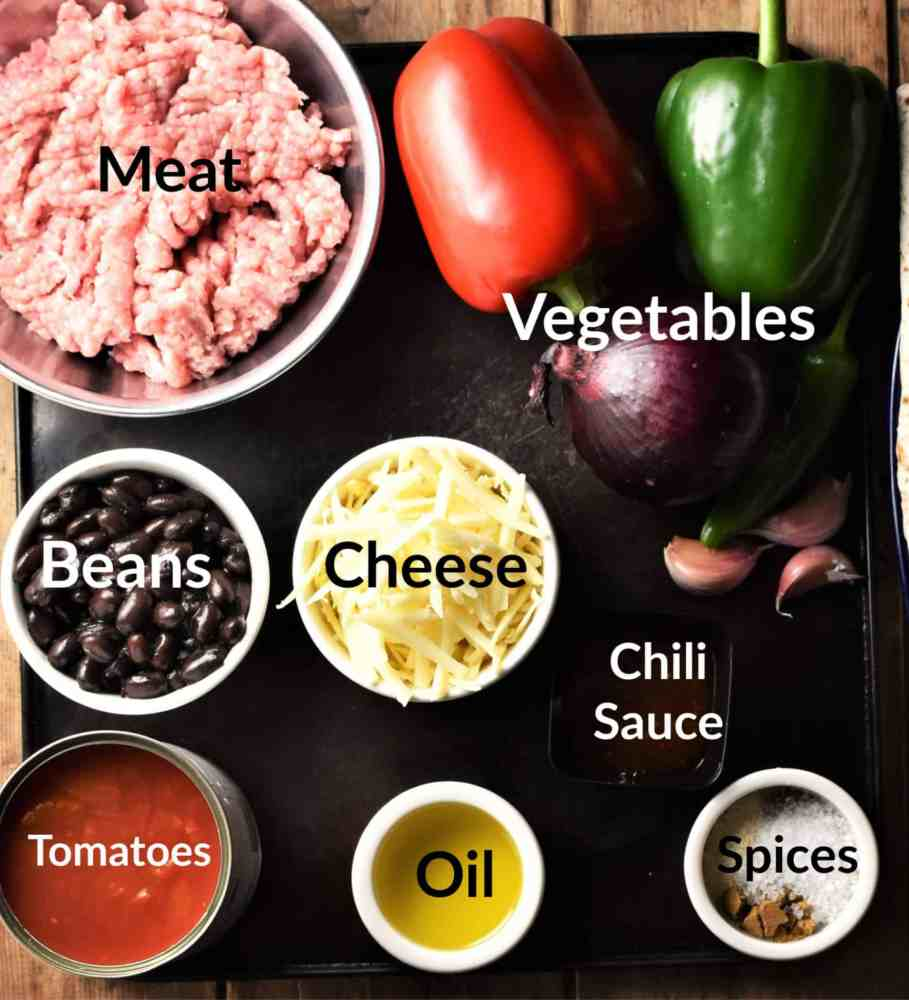 Tortilla bake ingredients in individual dishes.