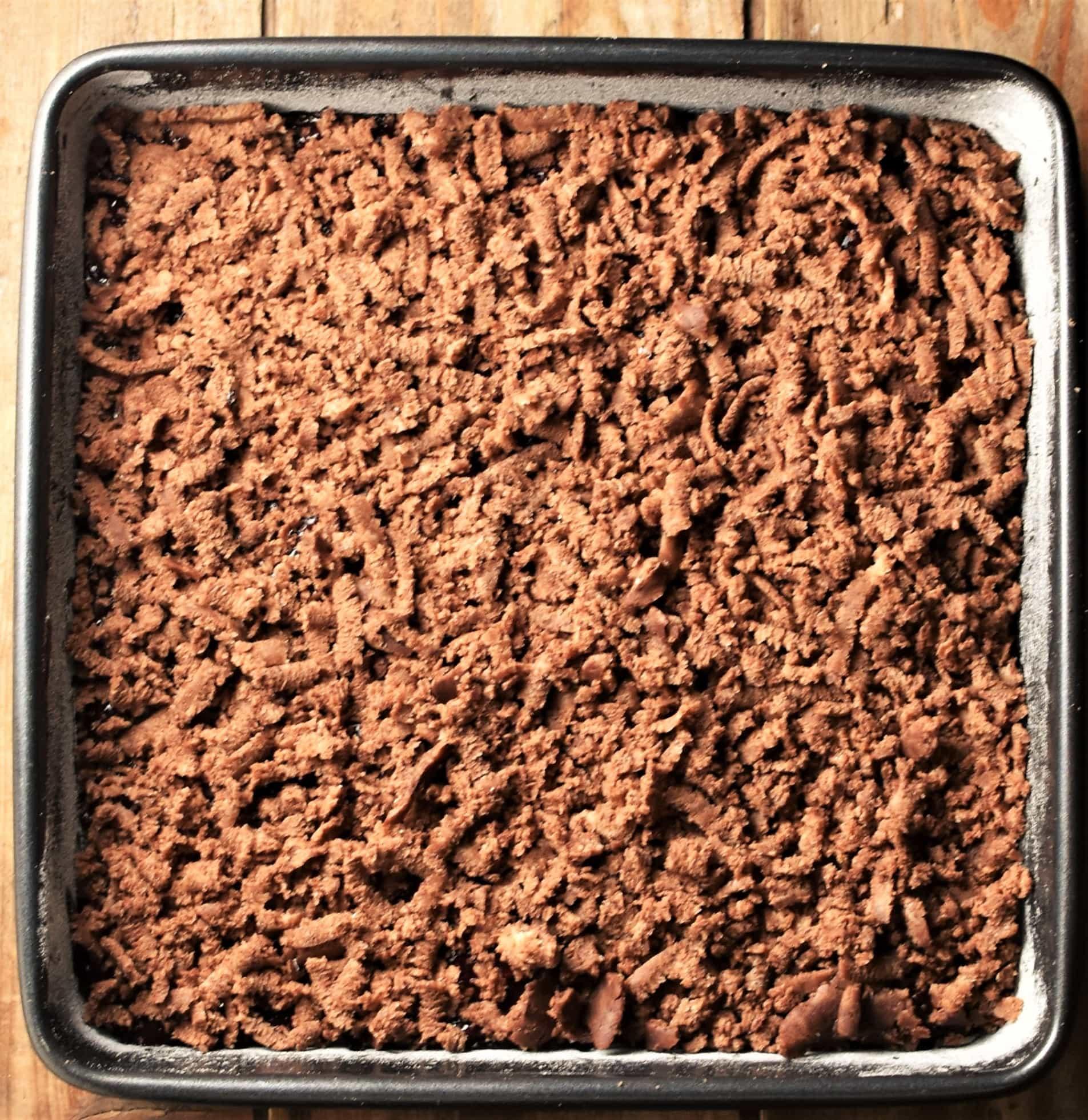 Cocoa crumb layer in square pan.