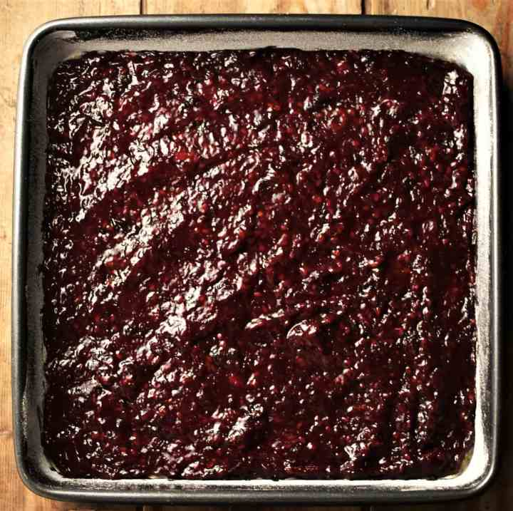 Layer of blackberry mixture in square pan.