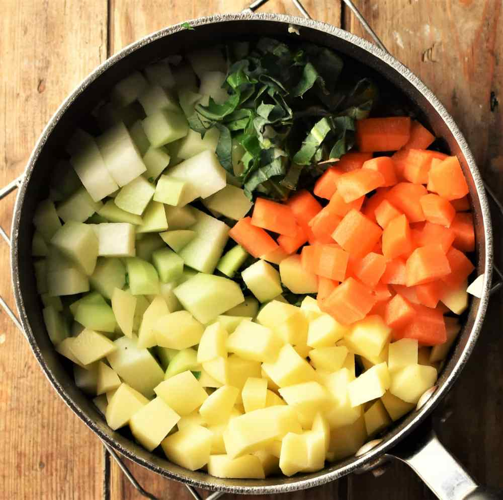 Peeled cubed vegetables in pot.