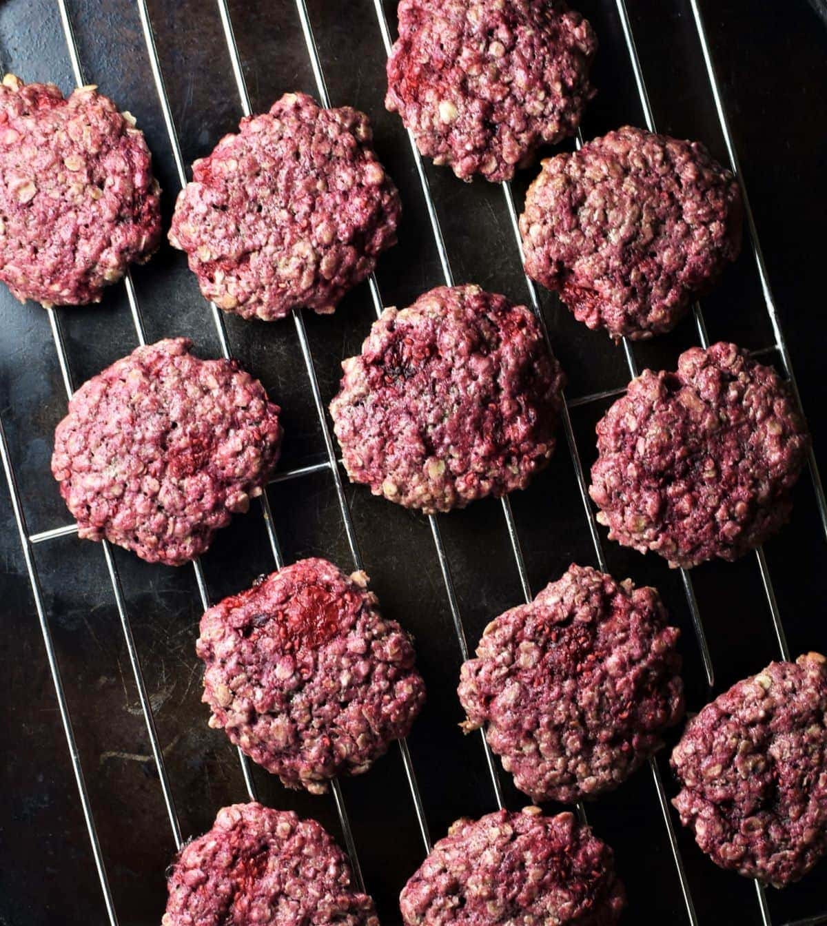 Raspberry cookies on top of rack.