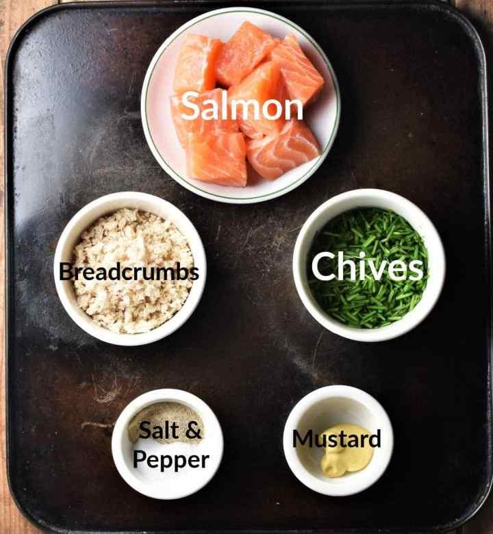 Salmon burger recipe ingredients in individual dishes.