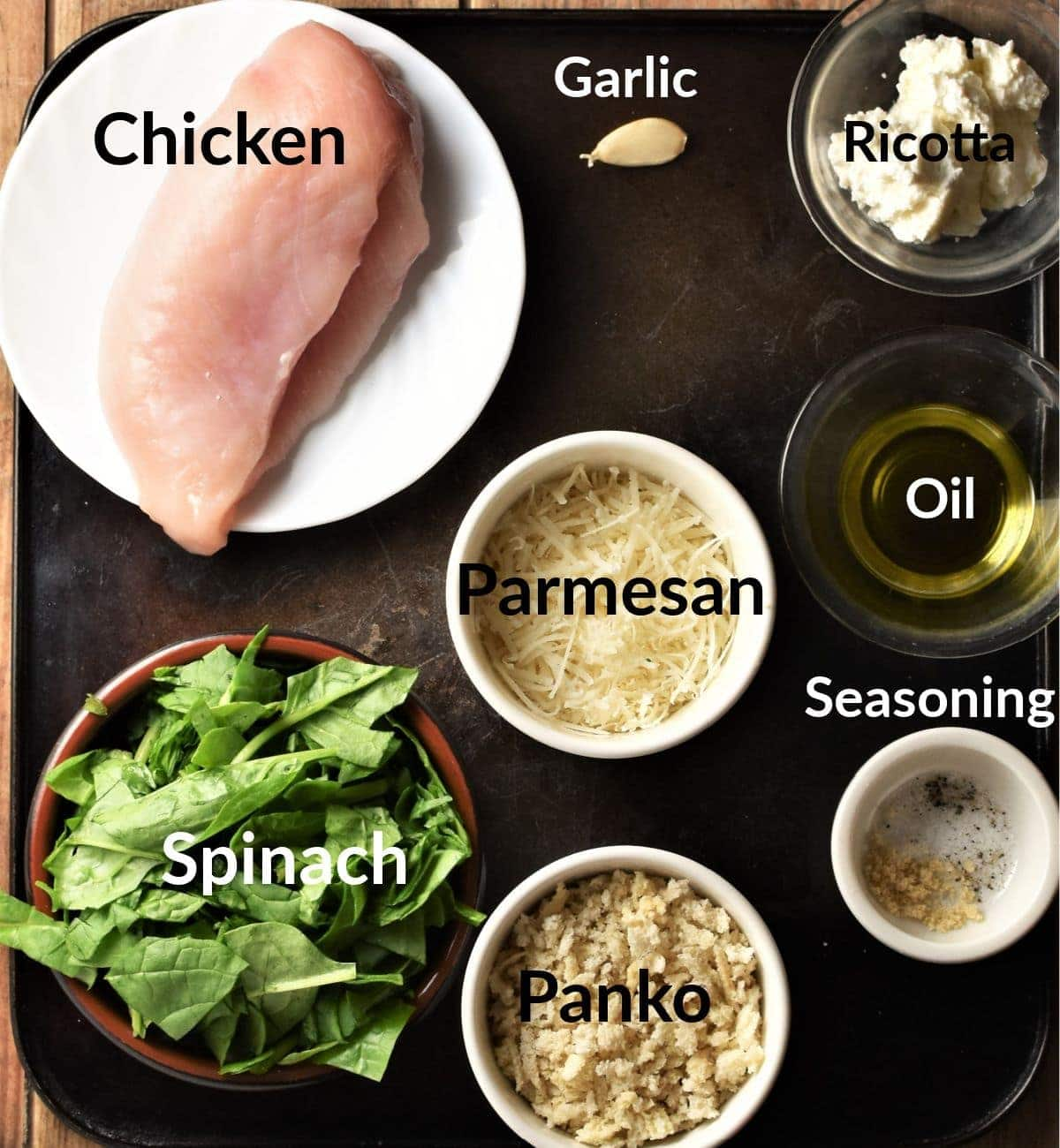 Spinach and cheese chicken ingredients in individual dishes.
