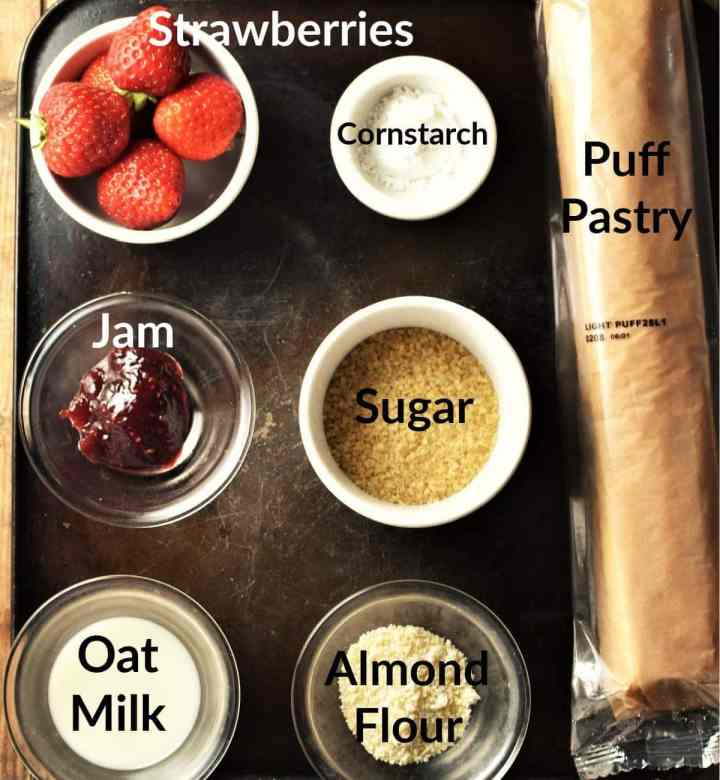 Vegan strawberry turnovers ingredients in individual dishes.