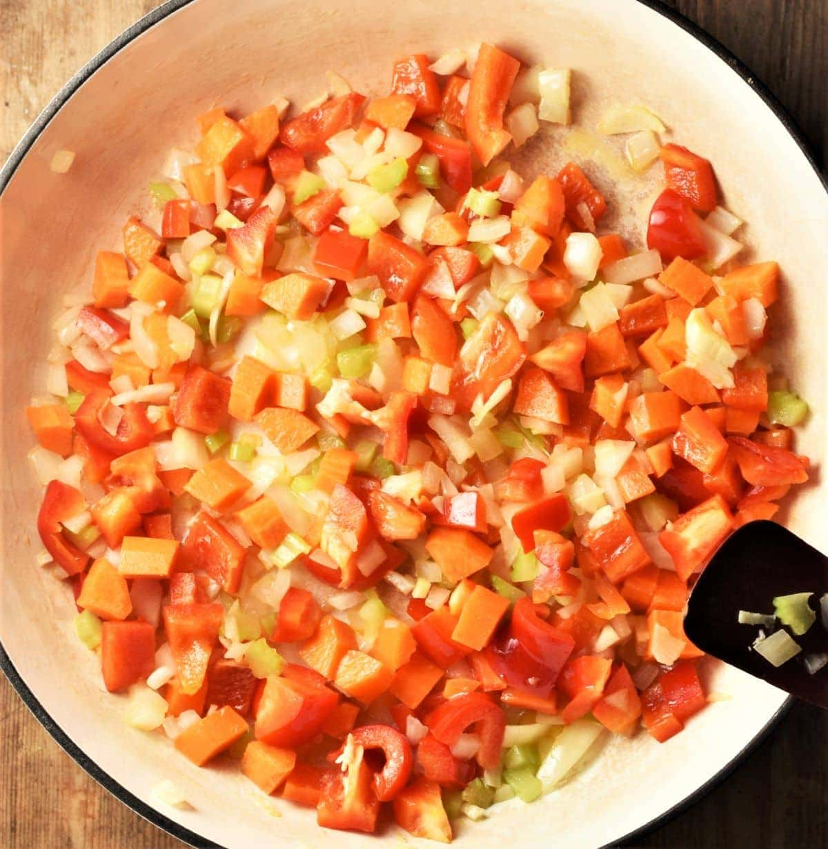 Chopped vegetables in white shallow pan.