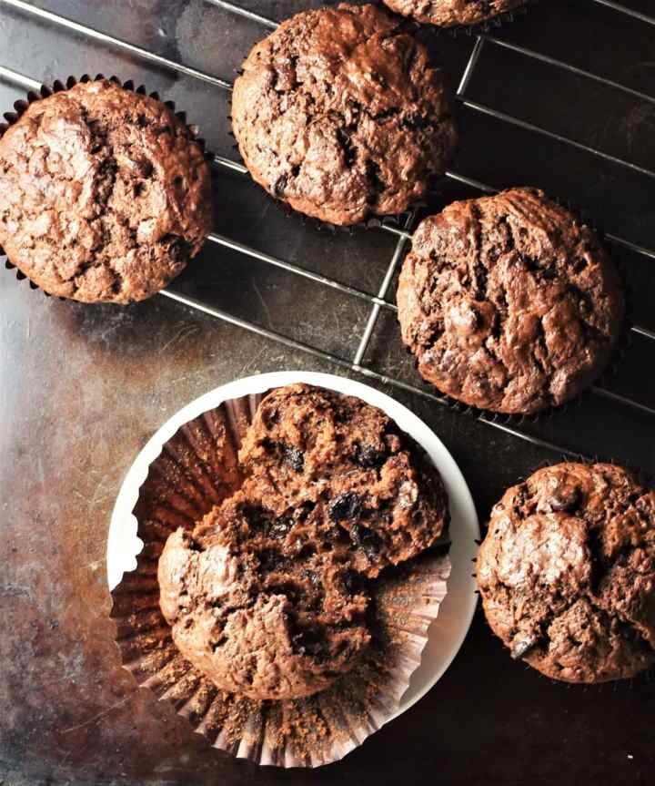 Top down view of chocolate sweet potato muffins on rack.