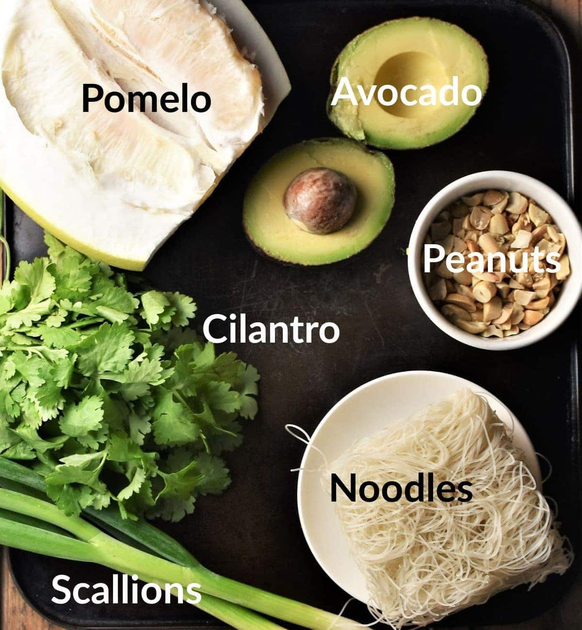 Pomelo salad ingredients in individual dishes.