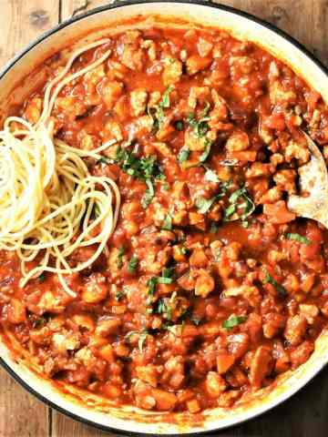 Bolognese sauce with tofu and spaghetti in large shallow pan.