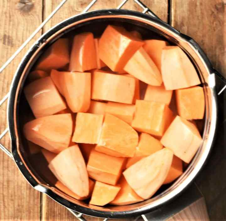 Peeled, cubed sweet potato in saucepan with water.