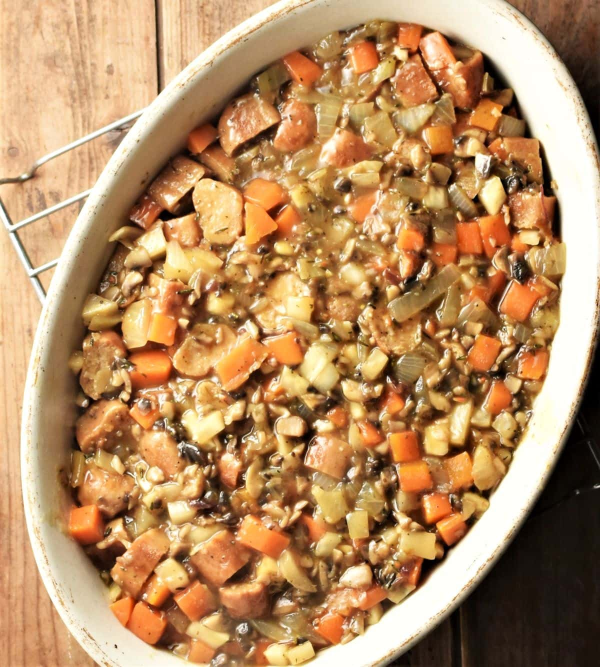 Sausage pie filling mixture inside oval dish.