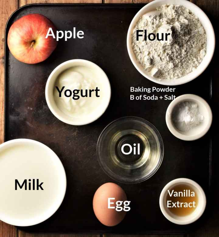 Ingredients for making Polish apple pancakes in individual dishes.