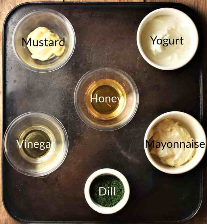 Ingredients for making dill, mustard and honey sauce in individual dishes.
