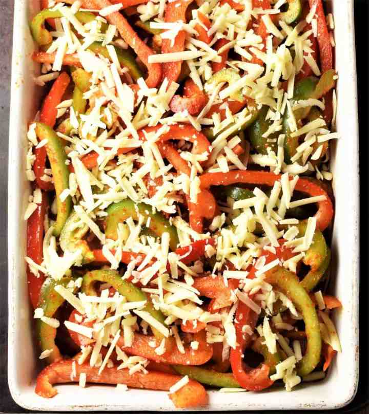 Top down view of unbaked casserole with peppers and cheese.