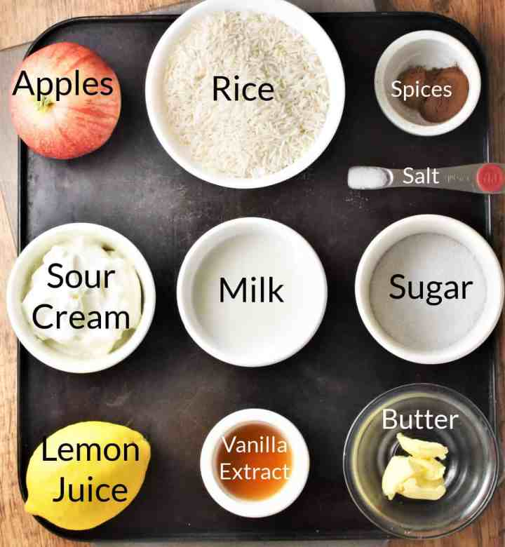 Ingredients for making Polish rice with apples in individual dishes.